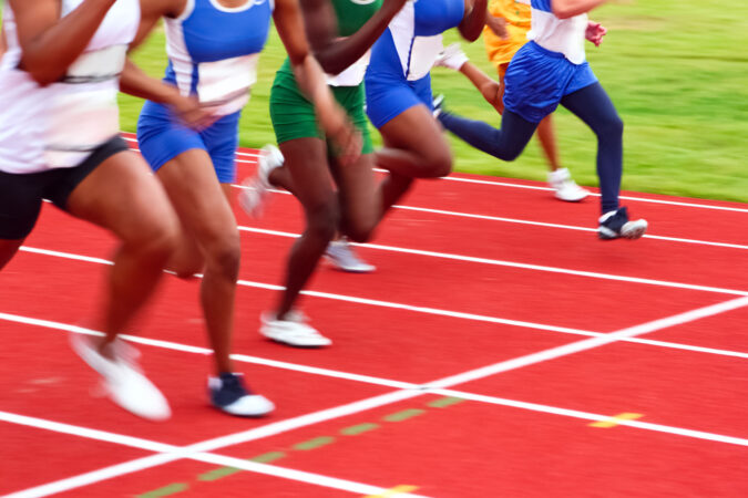 Motion blurred image of women in a track and field sprint event